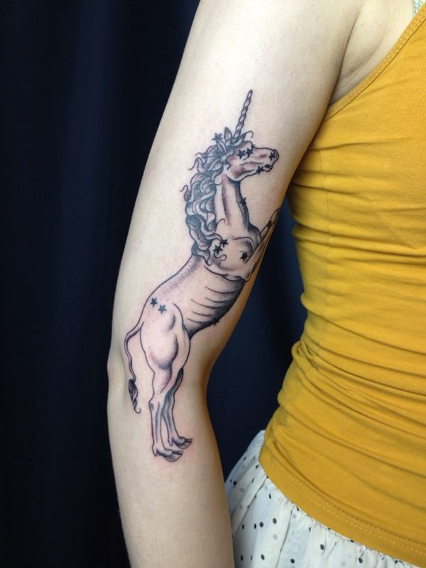 38280116-unicorn-tattoo-designs