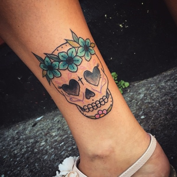 0ecfef320581b Pretty with a crown of flowers. skull-tattoos-10121538